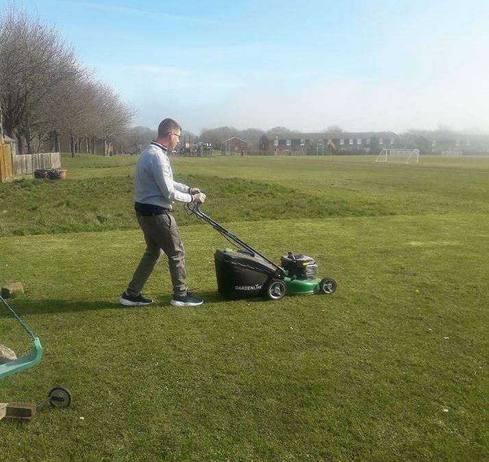 Jacob using the mower